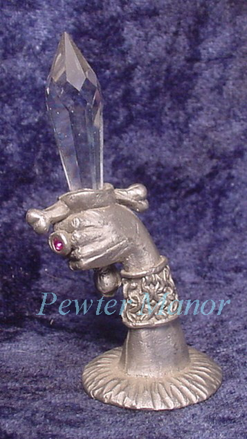 pewter hand with crystal sword